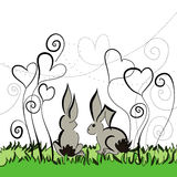 Two rabbits under the flowers Royalty Free Stock Image