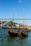 Two rabelo boats and bridge of Dom Luis , Portugal Stock Photography