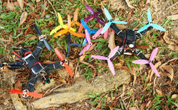 Two racing drone and broken propeller on field Stock Image