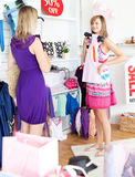 Two radiant women choosing clothes together Royalty Free Stock Photography