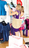 Two radiant women selecting item Royalty Free Stock Images