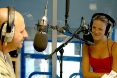 Two radio presenters. White male and female radio presenters in local radio station Royalty Free Stock Images