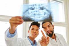 Two radiologists make x-ray image diagnose. Together in teamwork for oral surgery stock photo