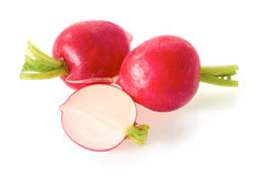 Two radish with half on white Royalty Free Stock Images