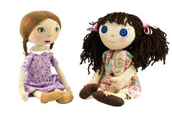 Two rag doll girls with blond and brow hairs. On white background stock images
