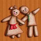 Ragdolls. Two rag dolls/ ginger men are smiling and holding hands Stock Image