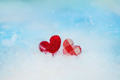 Two rag hearts on the snow Stock Photography