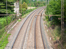 Two rail tracks. Two parallel rail tracks turning in the countryside Stock Photography