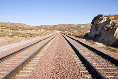 Two railroad tracks in the desert Stock Images