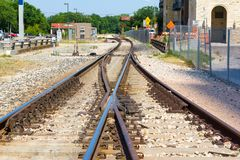 Two railroad tracks into one creating an X. Two railroad tracks into one royalty free stock photography