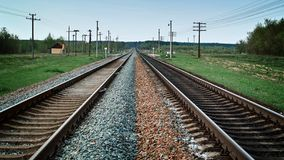 Two railroad tracks receding far Royalty Free Stock Photos