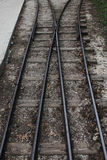 Two railroads meet and stand out. Old narrow railways going to perspective . Vertical Stock Photo