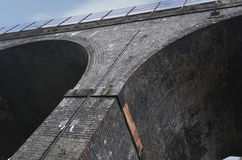 Two Railway Archways. A low angle shot underneath railway arches stock photos