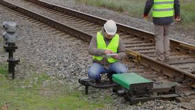 Two railway employees performing maintenance. Autumn Day stock footage