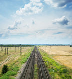 Two railways with crossing under dramatic sky Royalty Free Stock Photos