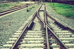 Two railways. Tracks merge close up.Vintage tone Stock Photos