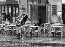 Two in the rain. B & W. stock photos