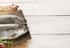 Two rainbow trouts on rustic wooden table. Healthy food royalty free stock photography