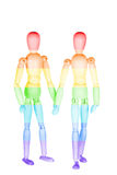 Two rainbow wooden little men Royalty Free Stock Image