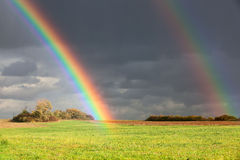 Two rainbows stock photo