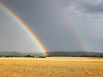 Two rainbows. On the cloudy sky Royalty Free Stock Photo