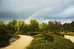 Two rainbows. Park with a storming sky and two rainbows Stock Photography