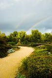 Two rainbows. Park with a storming sky and two rainbows Royalty Free Stock Photography