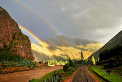 Two rainbows in the landscape. Picture of two rainbows in the landscape of Cusco, Perú, with the Andes mountains at the back Royalty Free Stock Image