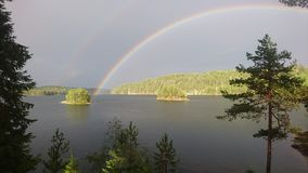 Two rainbows in one picure. Very awesome view at one lake in sweden Stock Images