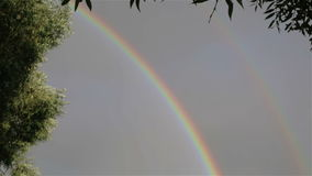 Two rainbows in the summer sky. stock video footage
