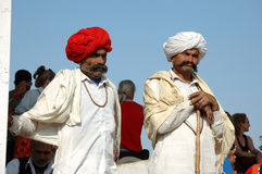 Two Rajasthani tribal men  attend the annual Pushkar Cattle Fair ,India Royalty Free Stock Photo