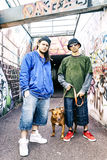 Two rap singers with a dog in a subway Stock Photo