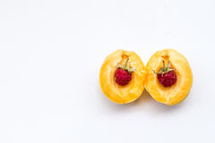 Two raspberries in part apricot, copy space stock images