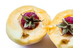 Two raspberries in part apricot, isolated royalty free stock photography