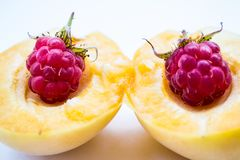 Two raspberries in part apricot royalty free stock images