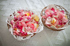 Basket full of rose petals. Two rattan baskets full of rose petals to throw at the wedding shallow depth of field photo royalty free stock images