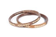 Two rattan bracelets isolated on white Stock Photos