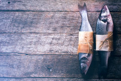 Two raw bass fish Royalty Free Stock Image