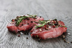 Two raw beef steaks in spicies Royalty Free Stock Images