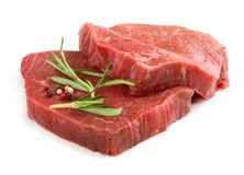 Two raw beef steaks. With rosemary isolated on white background Royalty Free Stock Photo