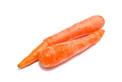 Two raw carrots on white. Background Royalty Free Stock Photo