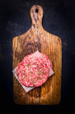 Two raw cutlet for burger on cutting board with dill  wooden rustic background top view close up Stock Photos