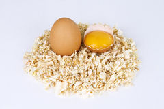 Two raw eggs. Close up on two raw eggs, one broken, one whole isolated on white background Royalty Free Stock Photo
