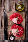 Two raw fresh beef veal shank meat for ossobuco. On wooden background Royalty Free Stock Photo