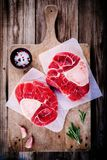 Two raw fresh beef veal shank meat for ossobuco. On wooden background Stock Photo