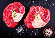 Two raw fresh veal shank meat for ossobuco. On dark background Stock Images