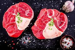 Two raw fresh veal shank meat for ossobuco. On dark background Royalty Free Stock Photography