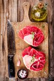 Two raw fresh veal shank meat for ossobuco. On wooden background Stock Photography