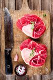 Two raw fresh veal shank meat for ossobuco. On wooden background Royalty Free Stock Photography