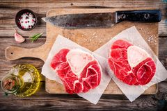 Two raw fresh veal shank meat for ossobuco. On wooden background Stock Image